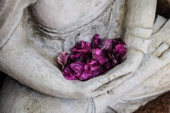 Buddhist statue with flowers
