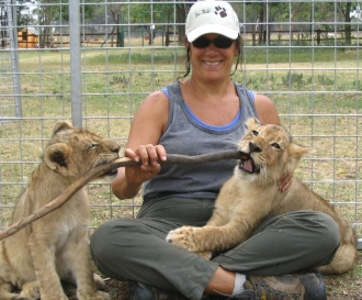 instructor Joyce Major with lion cubs